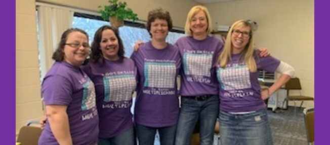 Some of our Middle House teachers model multiplication table t-shirts