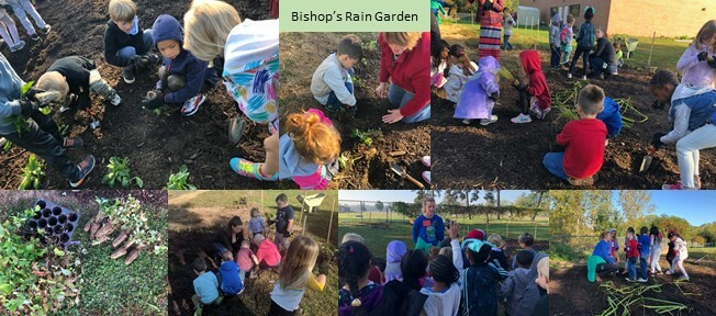 Students, parents, teachers and staff from Washtenaw County Department of Water Resources work together to plant a rain garden at Bishop Elementary School.