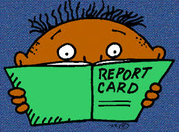 Boy holding report card